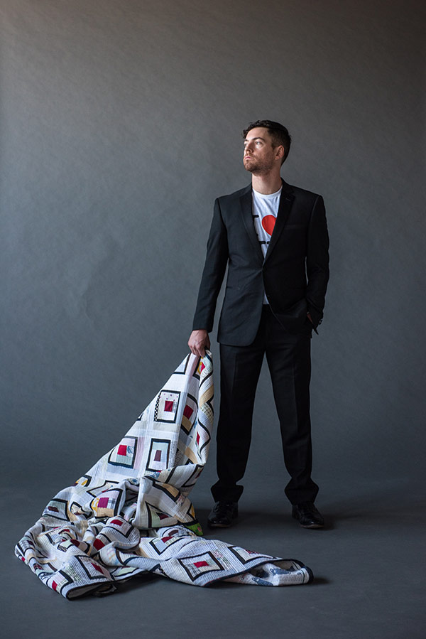 Luke Haynes with one of his quilts