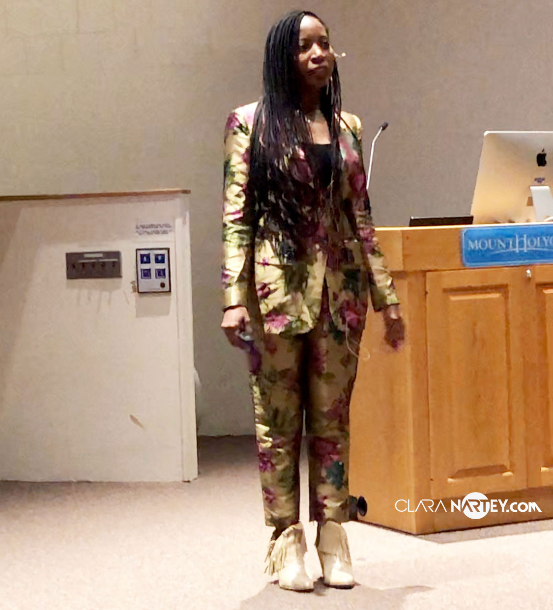 Bisa Butler speaking in the Gamble Auditorium at Mount Holyoke College Art Museum on The Broom Jumpers